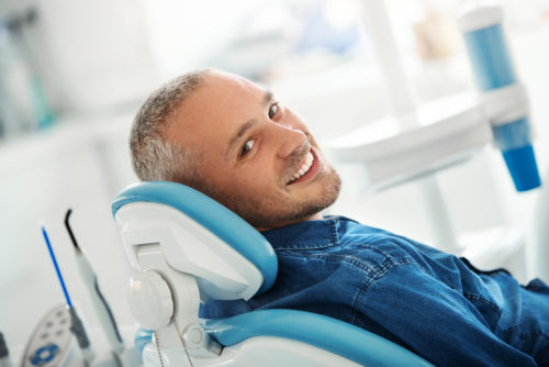 Man waiting for dental appointment